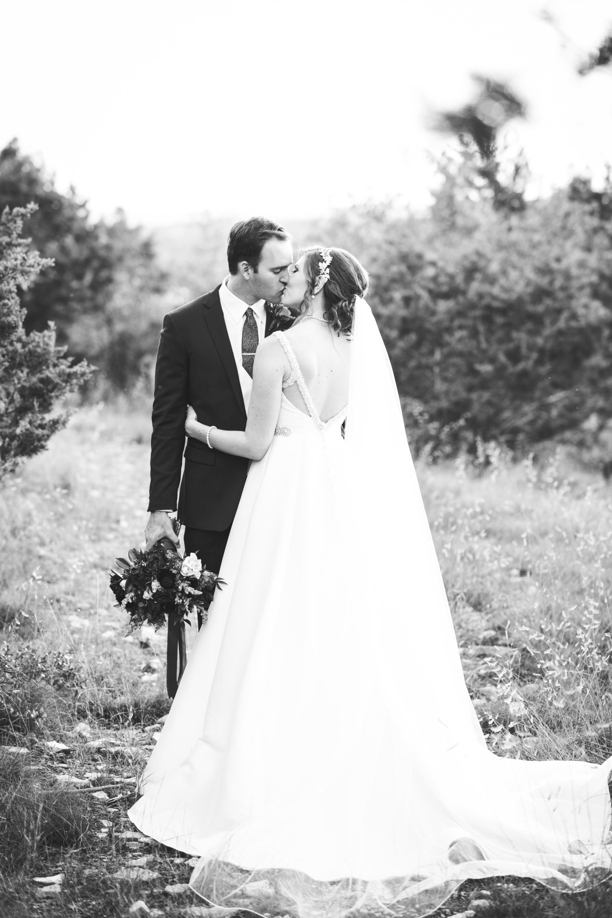 terrace club wedding photographer romantic kiss bride groom natural light 2600 US-290, Dripping Springs, TX 78620