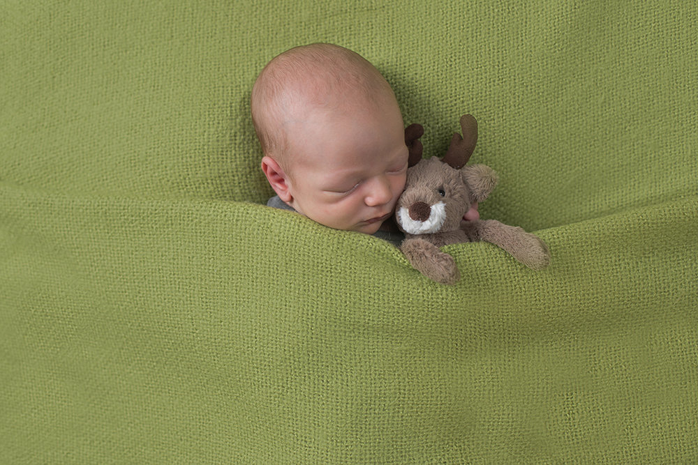 baby boy with Christmas reindeer