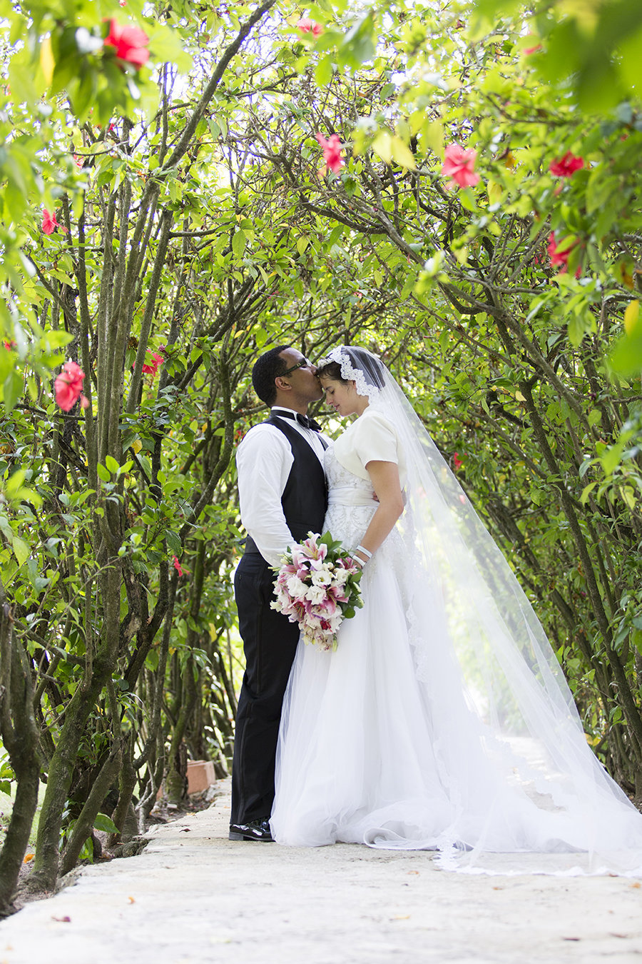 1Rebekah&DanielWedding379 dominican repulic destination wedding arch of flowers bride and groom cathedral veil travel photographer