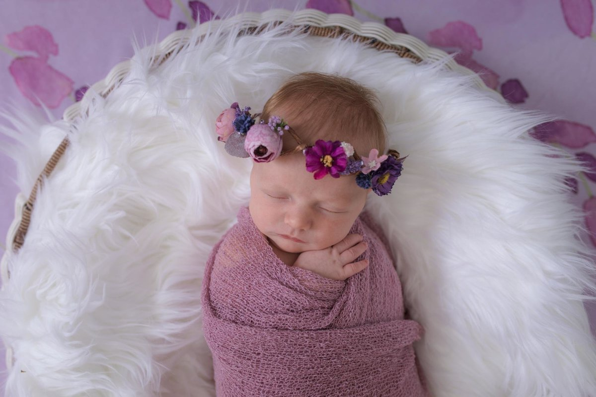 newborn girl with floral crown