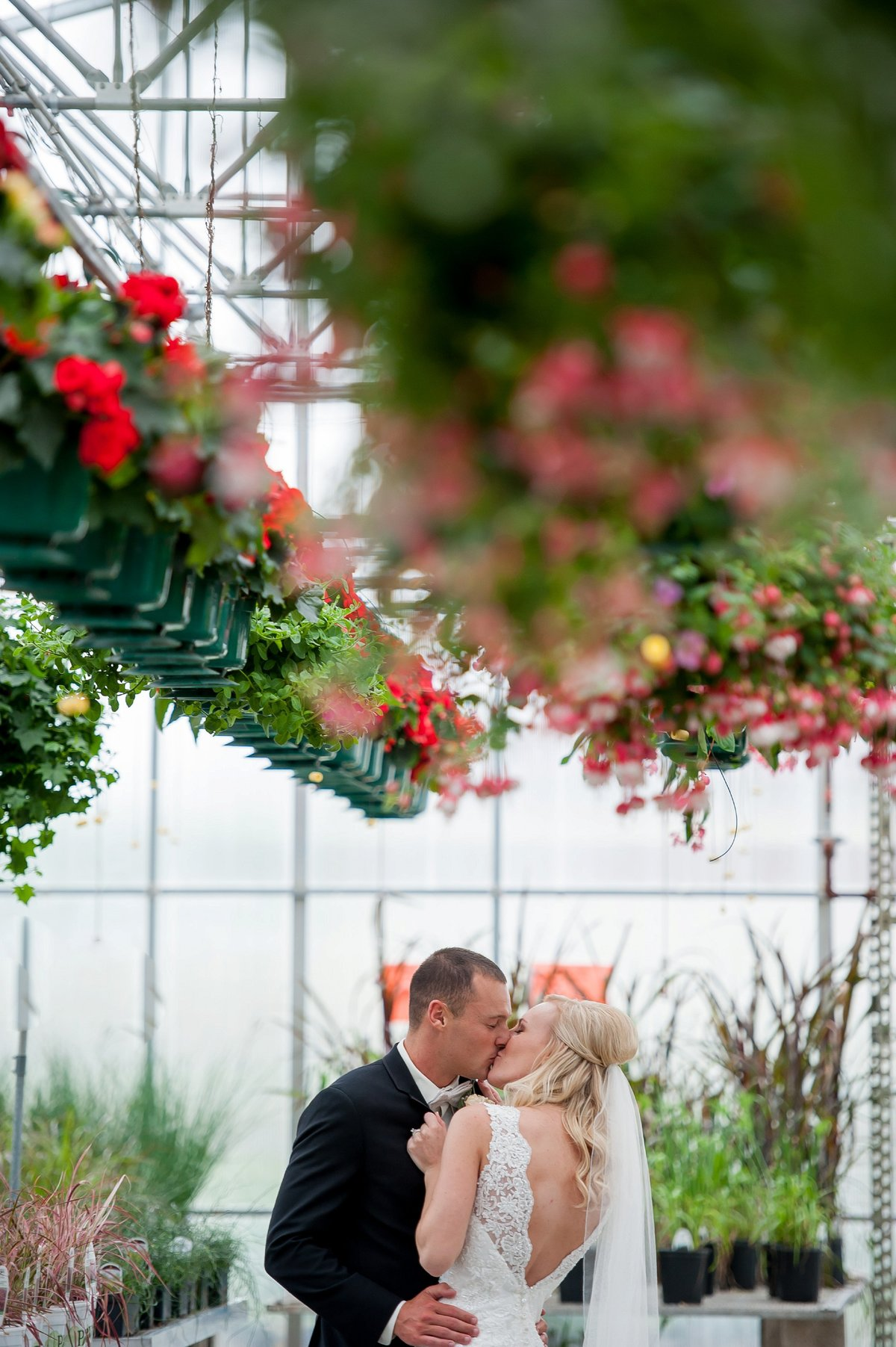 boho style greenhouse spring wedding in Fargo Moorhead photographed by Kris Kandel