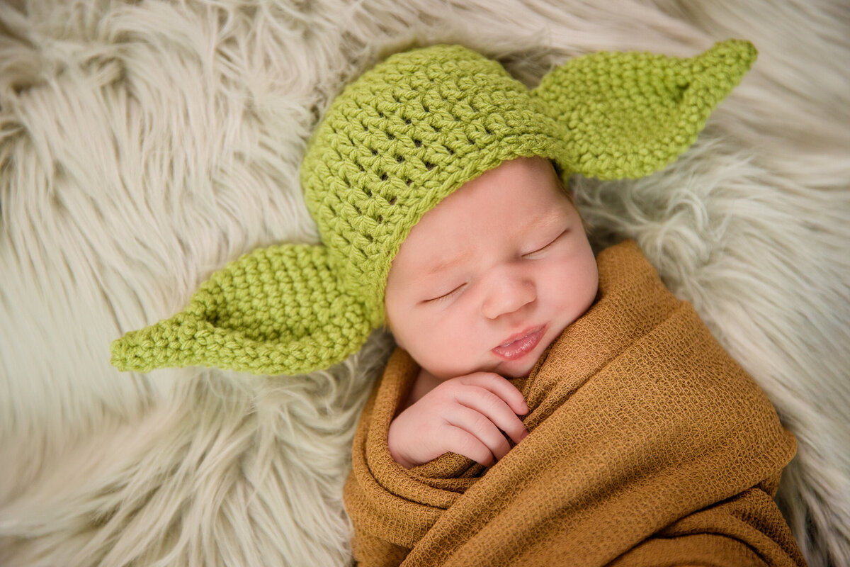 Yoda newborn photo posed in studio