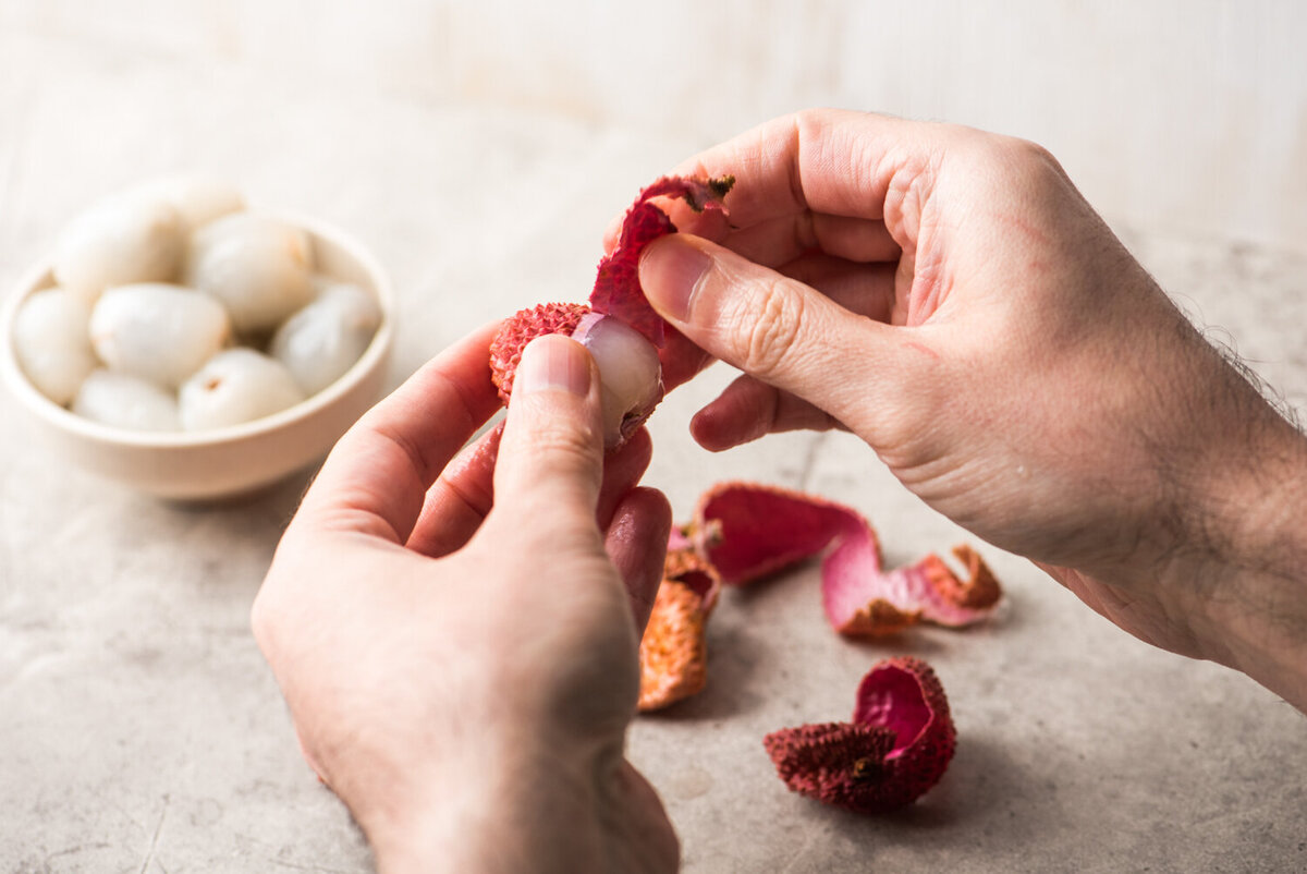 peeling a lychee for the spruce eats