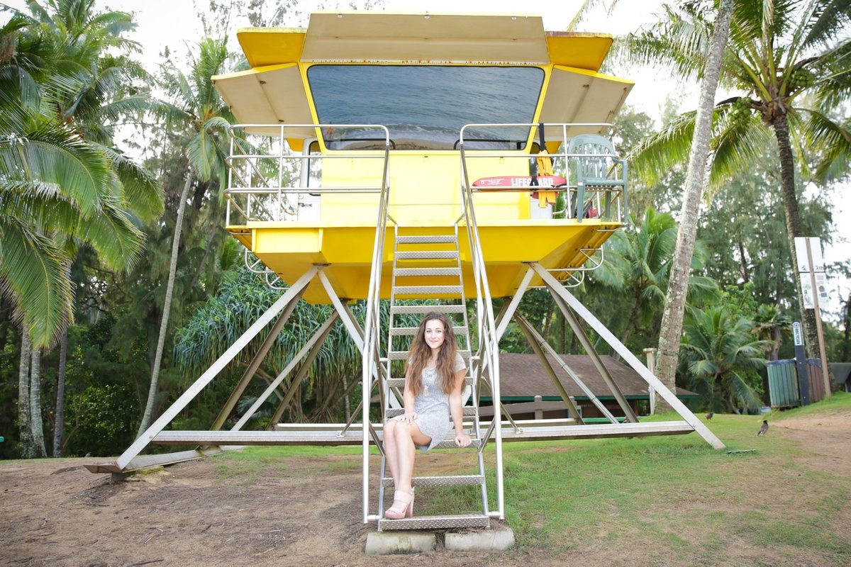 Capture Aloha Photography, Maui Senior Portrait Photography sitting at the stairs of yellow beach house