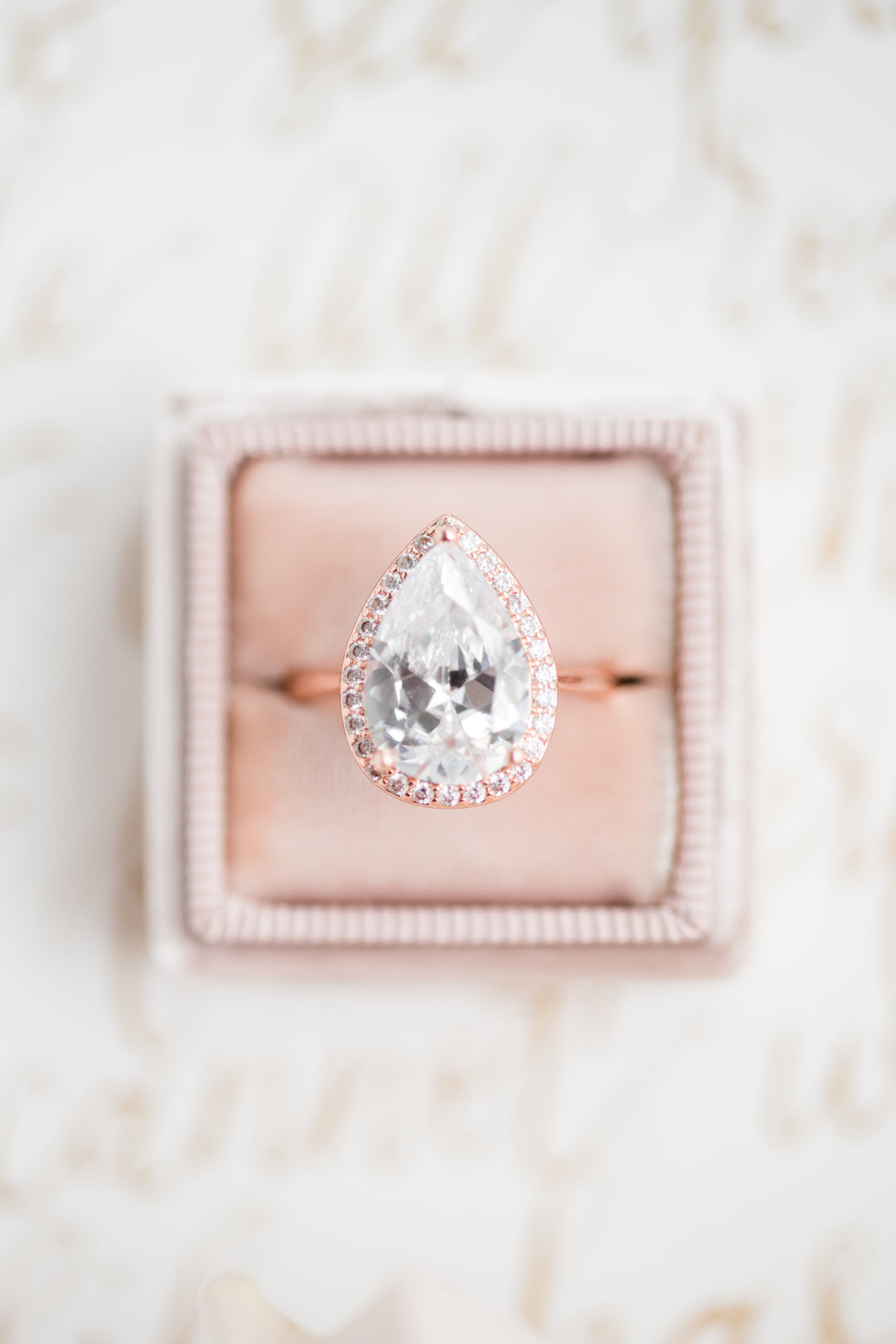 Pear shaped diamond ring in pink The Mrs. Box