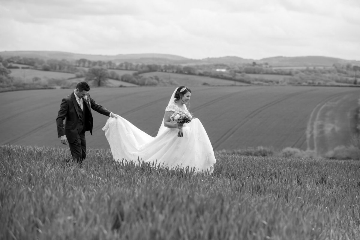Couple on their wedding day at The Oak Barn in Devon