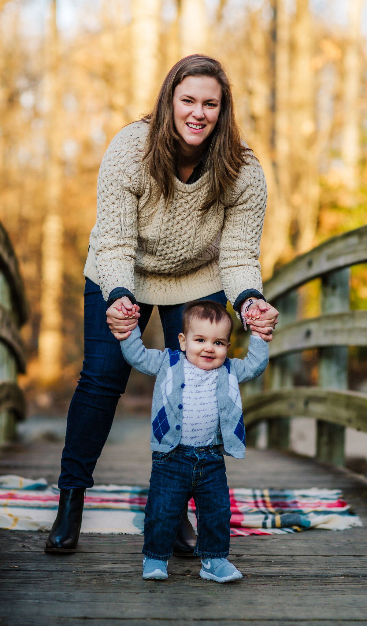 Mom and Baby standing on bridge