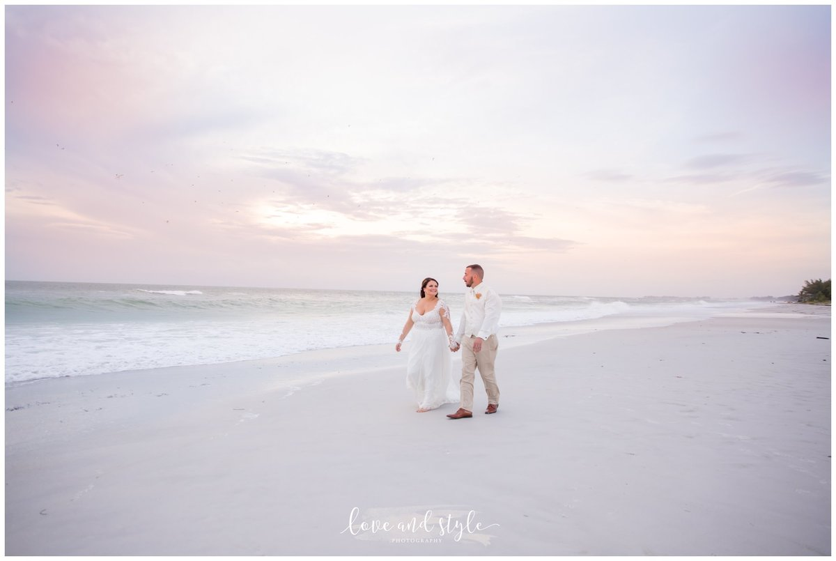 Anna Maria Island Wedding Photography of the bride and groom walking on the beach