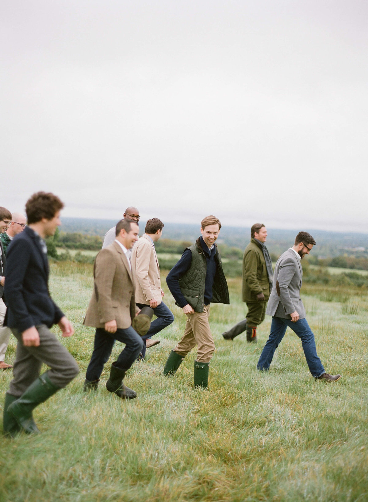 20-KTMerry-destination-weddings-groomsmen-walking-Ireland