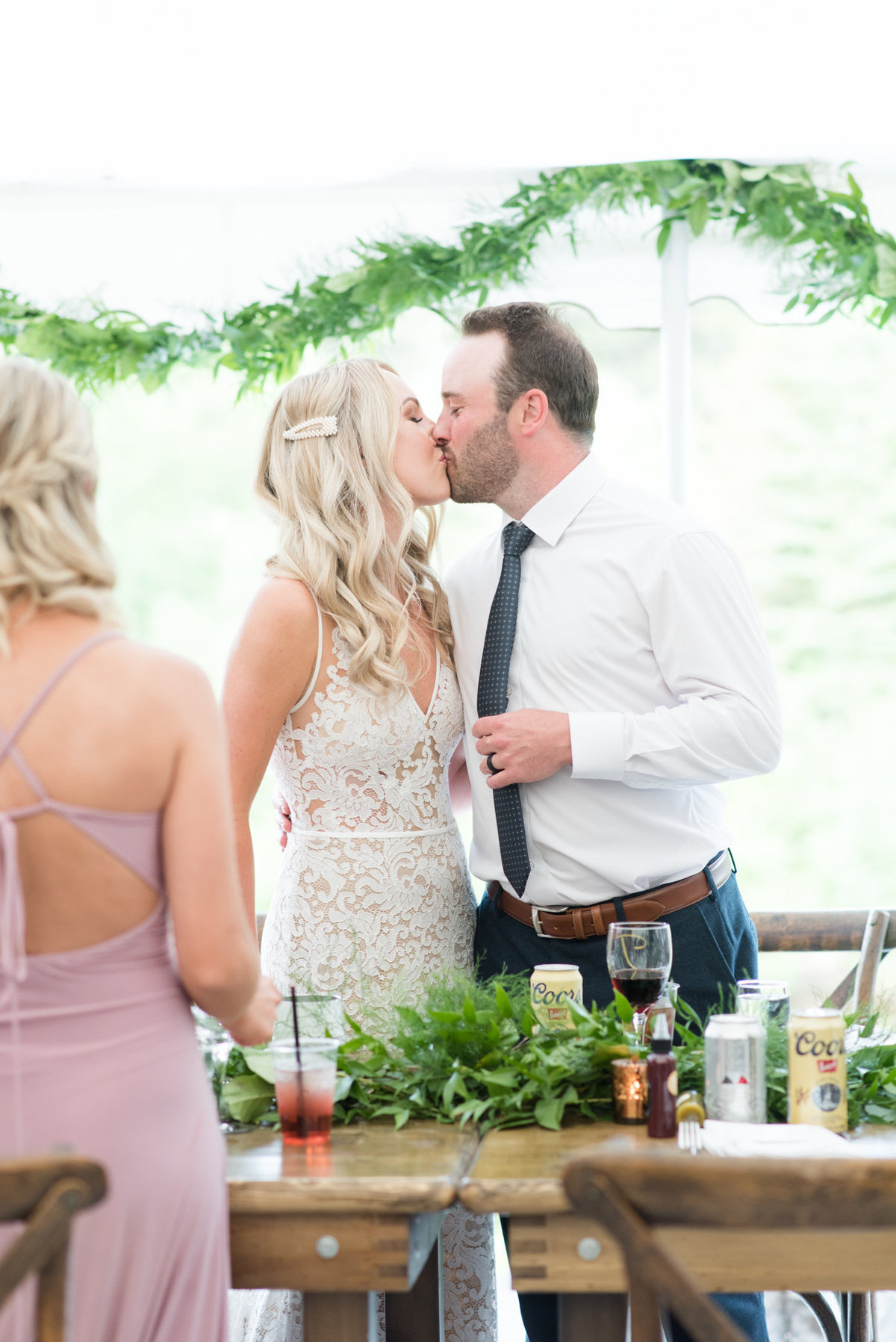 Bride and groom share a kiss during their reception at Stepstone Centre in Thunder Bay