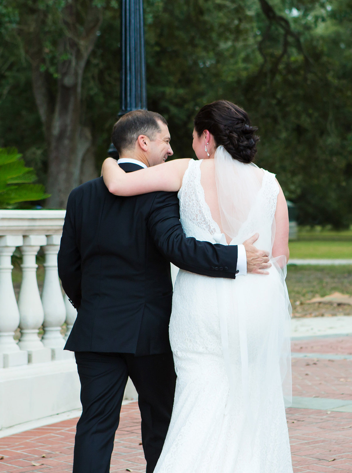 happily married NOLA wedding couple walk down cement aisle at Newman Bandstand