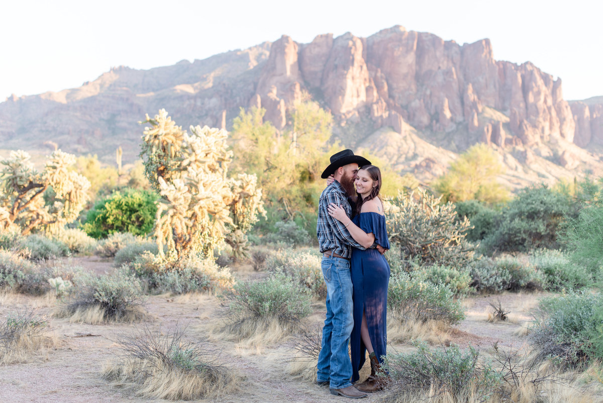 couple hugs each other at lost dutchman