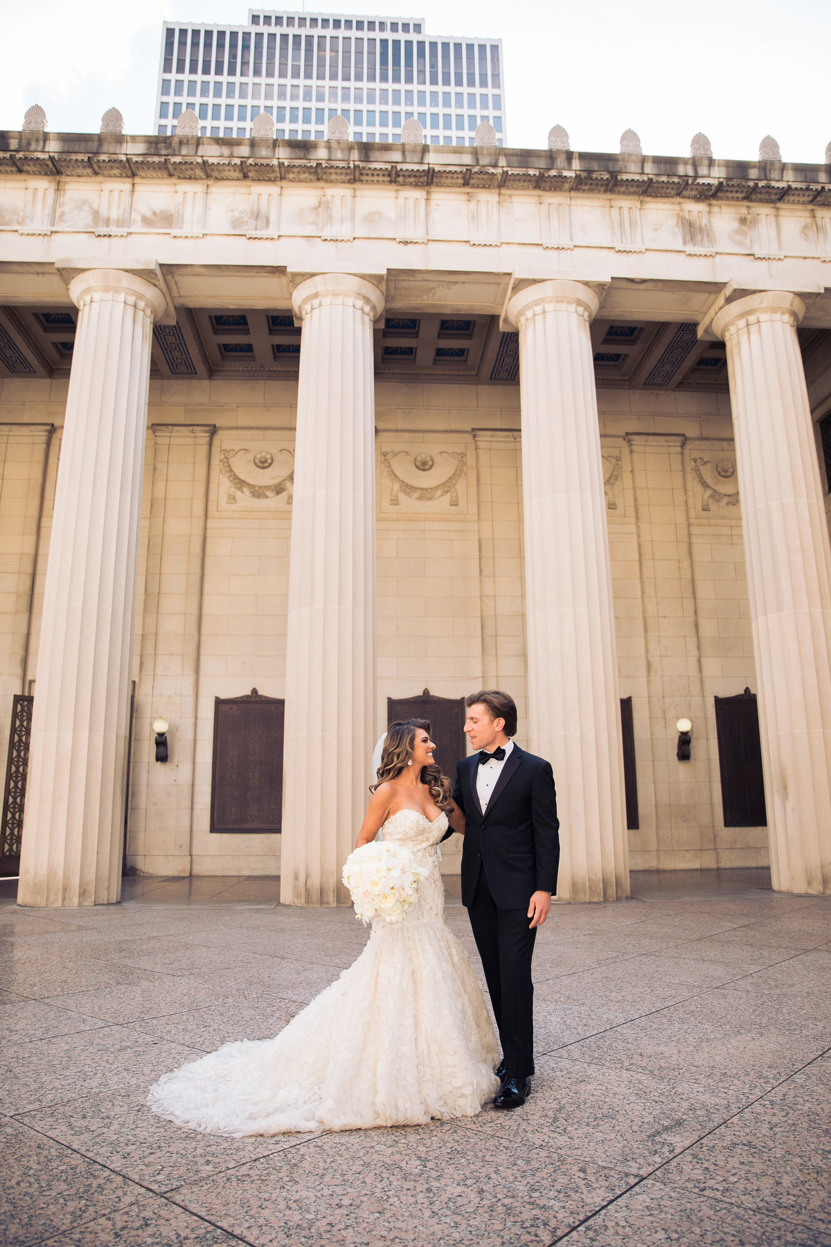 Bride and Groom in front of the columns at War Memorial.