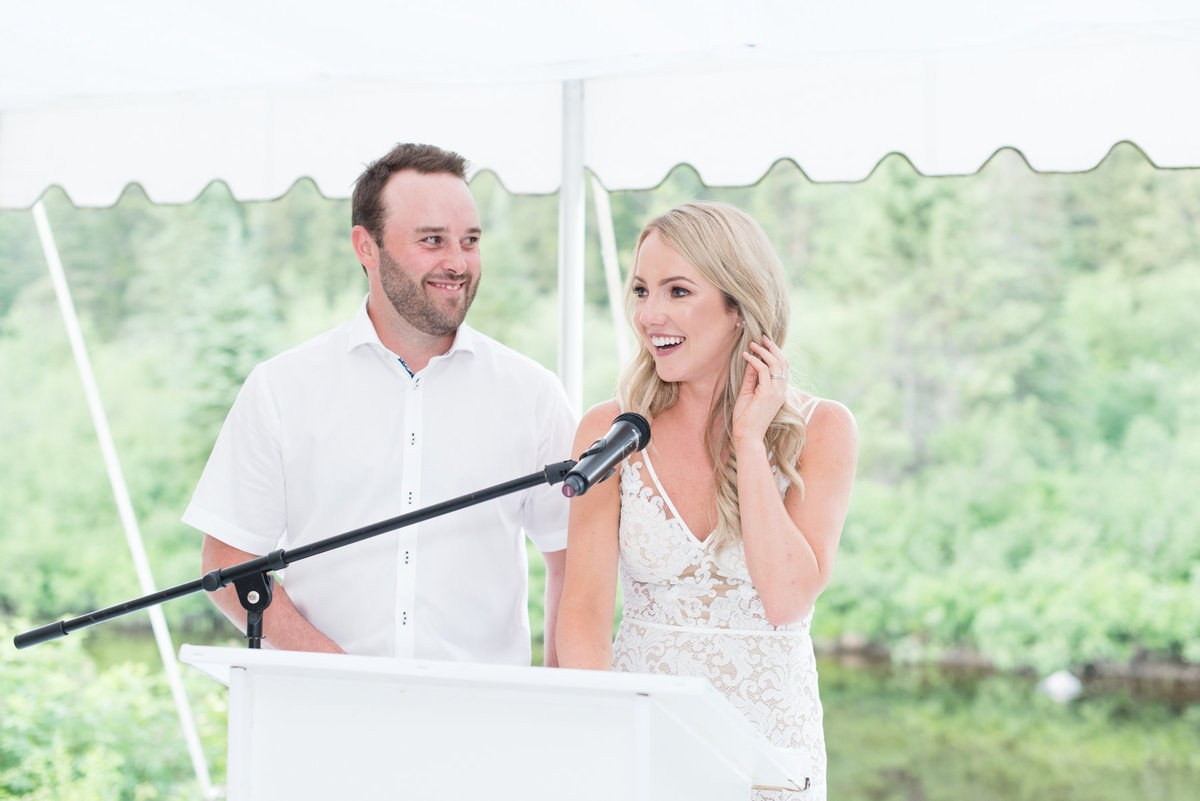 Bride and groom give speech during their wedding at Stepstone Centre in Thunder Bay