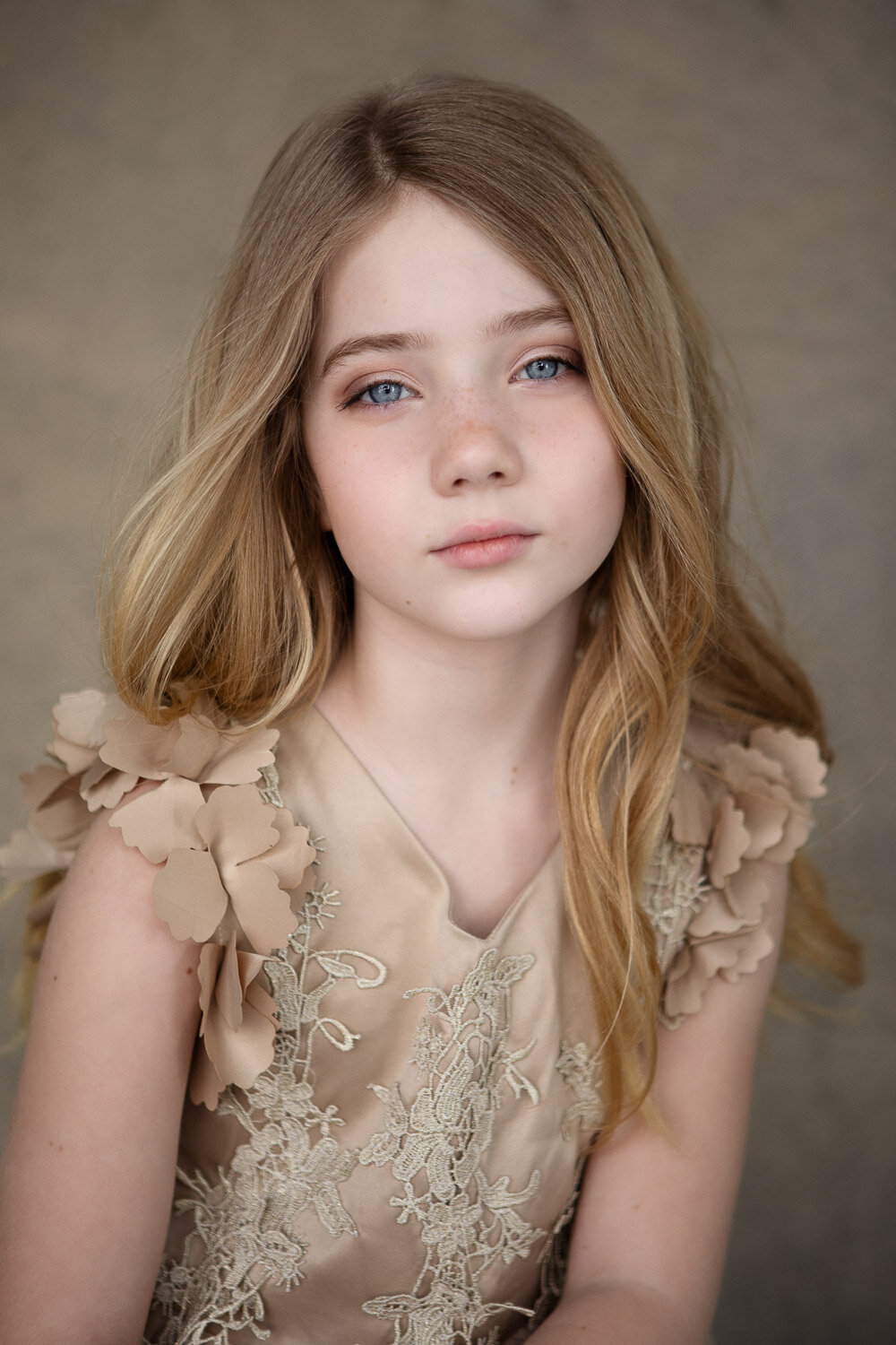 Professional little beauty portrait of girl in gold dress in Buffalo, New York