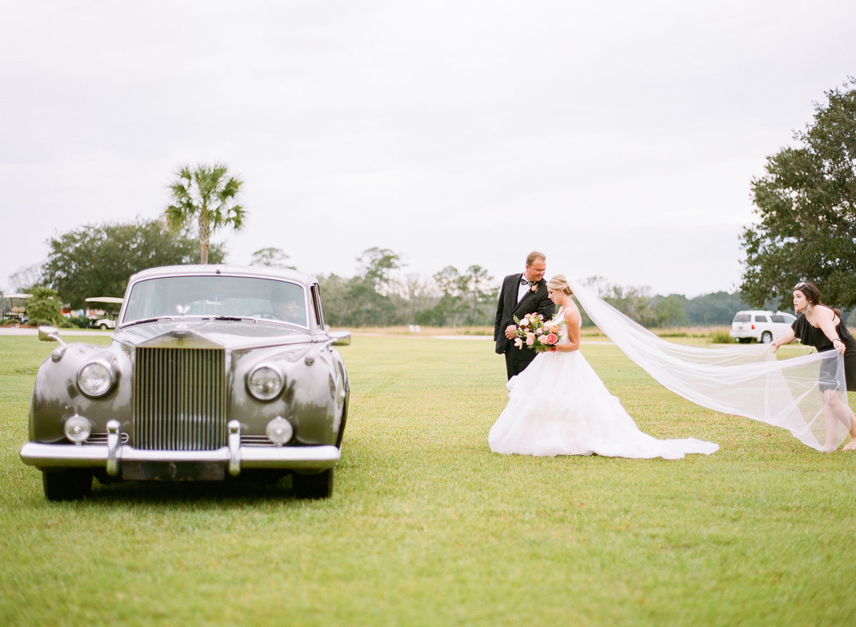 Bride and Dad head to Charleston Wedding Ceremony Long cathedral length veil Entrance with 1961 Grey Rolls Royce