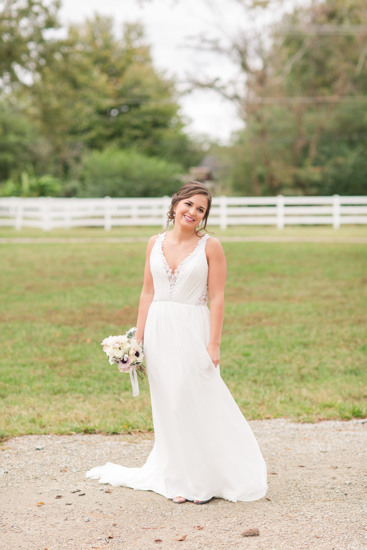 Bride smiling happily on her wedding day at Culpepper Barn in Pungo
