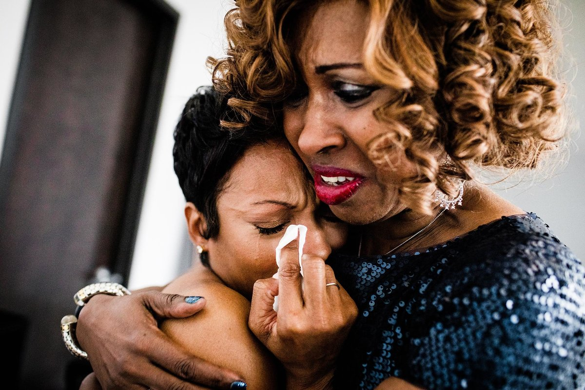 A bride is comforted by her mother-in-law during a 19 East Chicago wedding.
