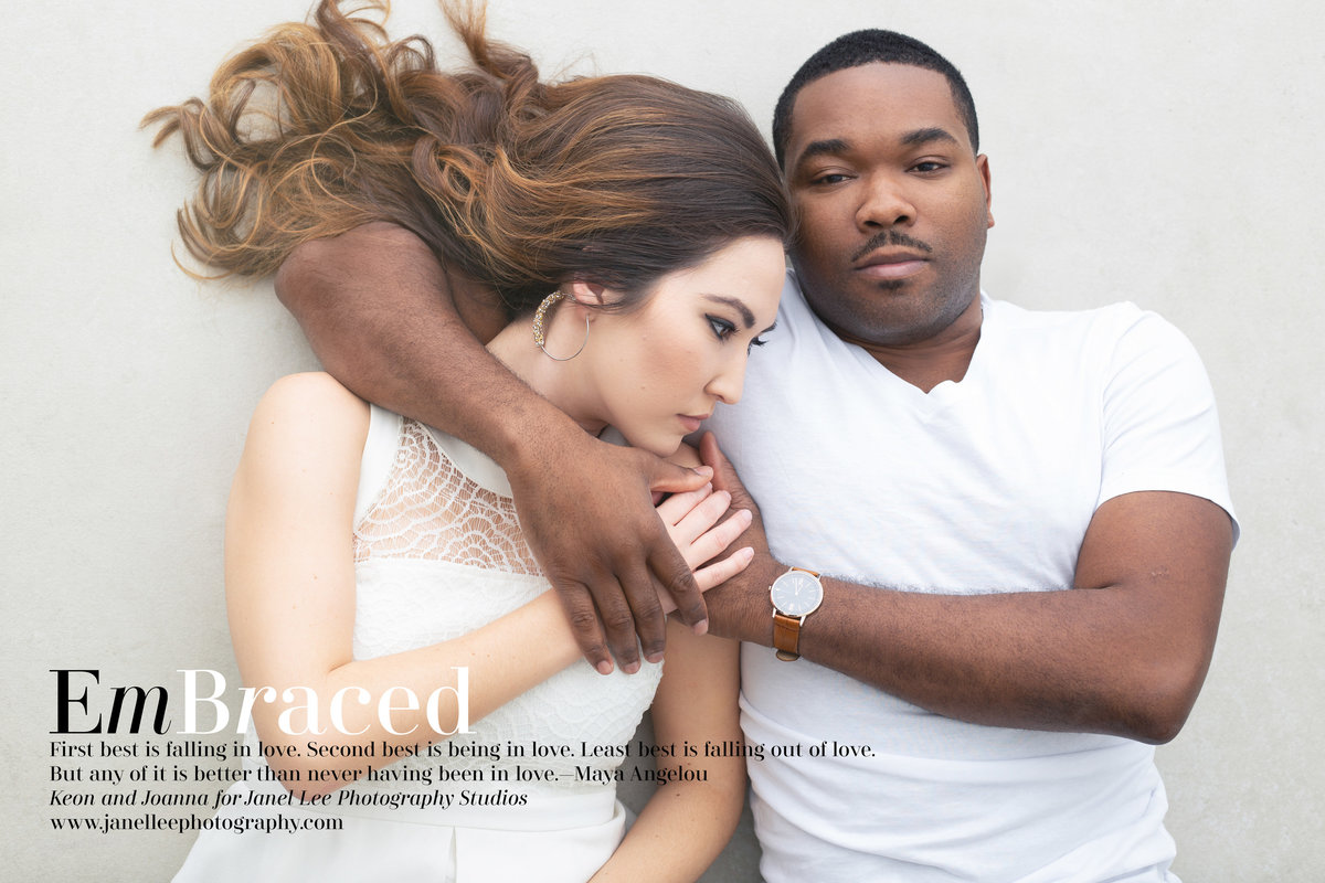 An African American man and an Asian woman embrace as they pose for an editorial portrait at Janel Lee Photography Studios in Cincinnati Ohio