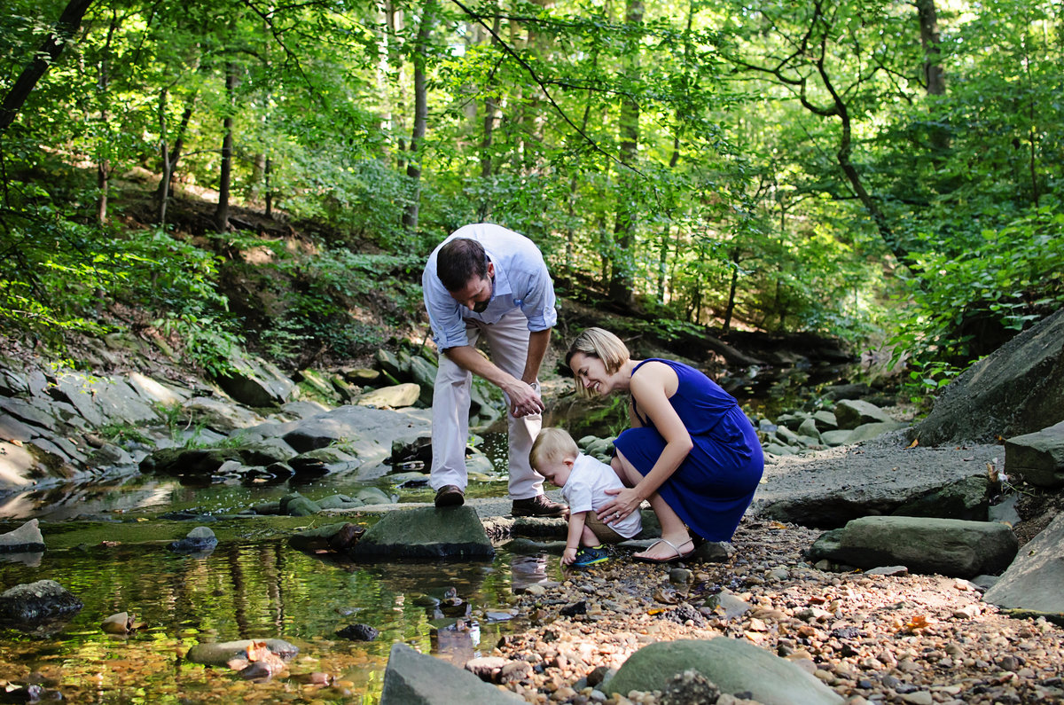 Portrait of a family of three playing in the creek at Lubber Run Park in Arlington, Virginia taken by Sarah Alice Photography