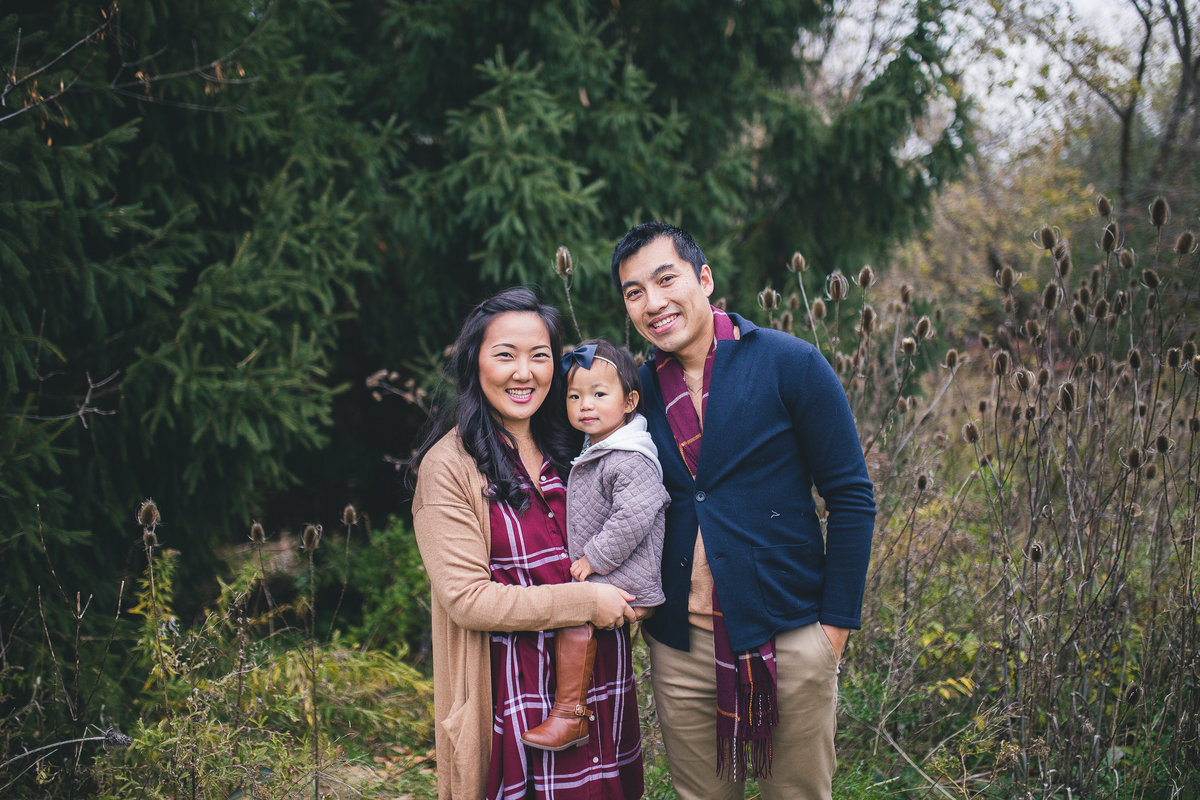 Family of 3 standing in field and smiling {Burlington Family Photographer}
