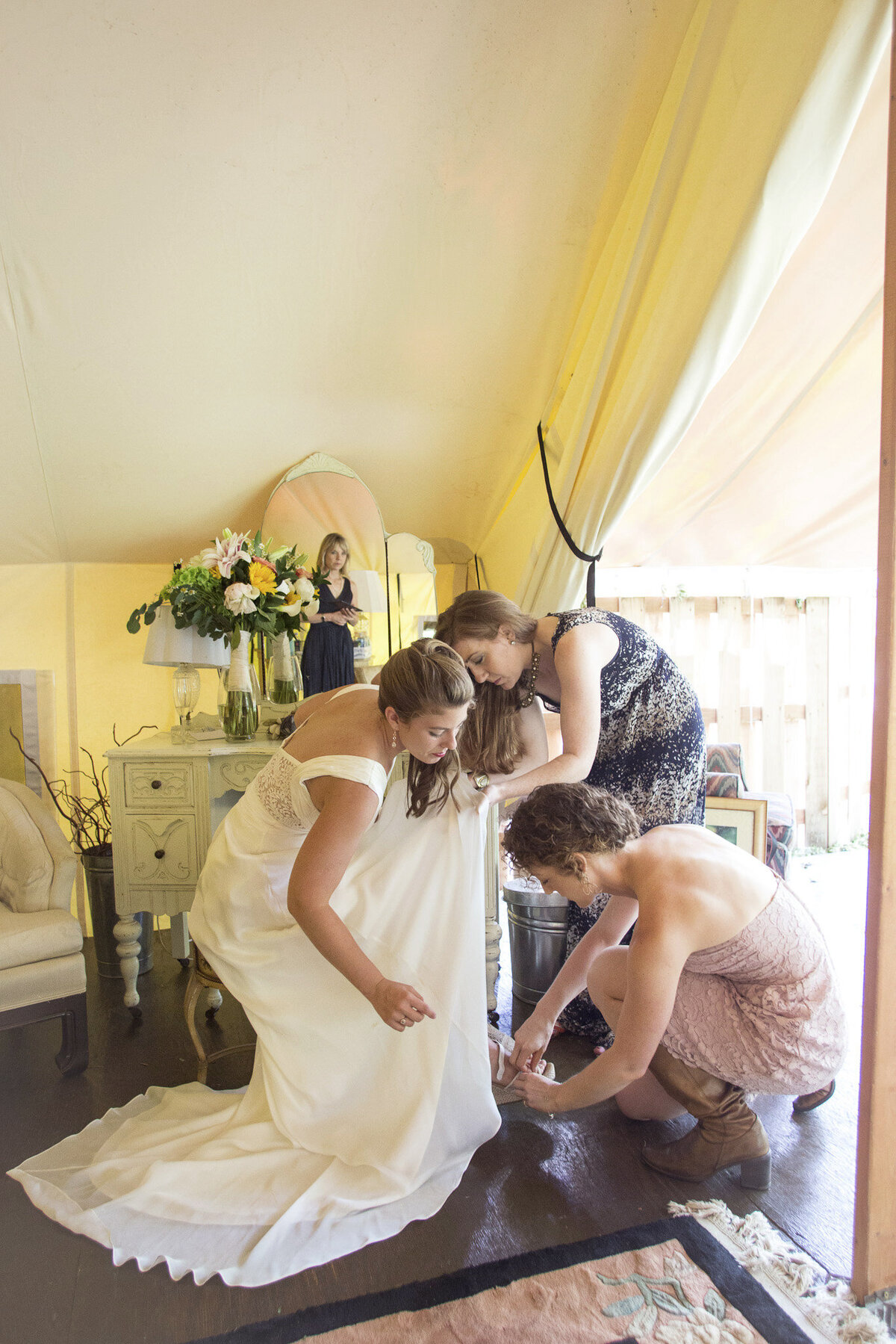helping bride get ready