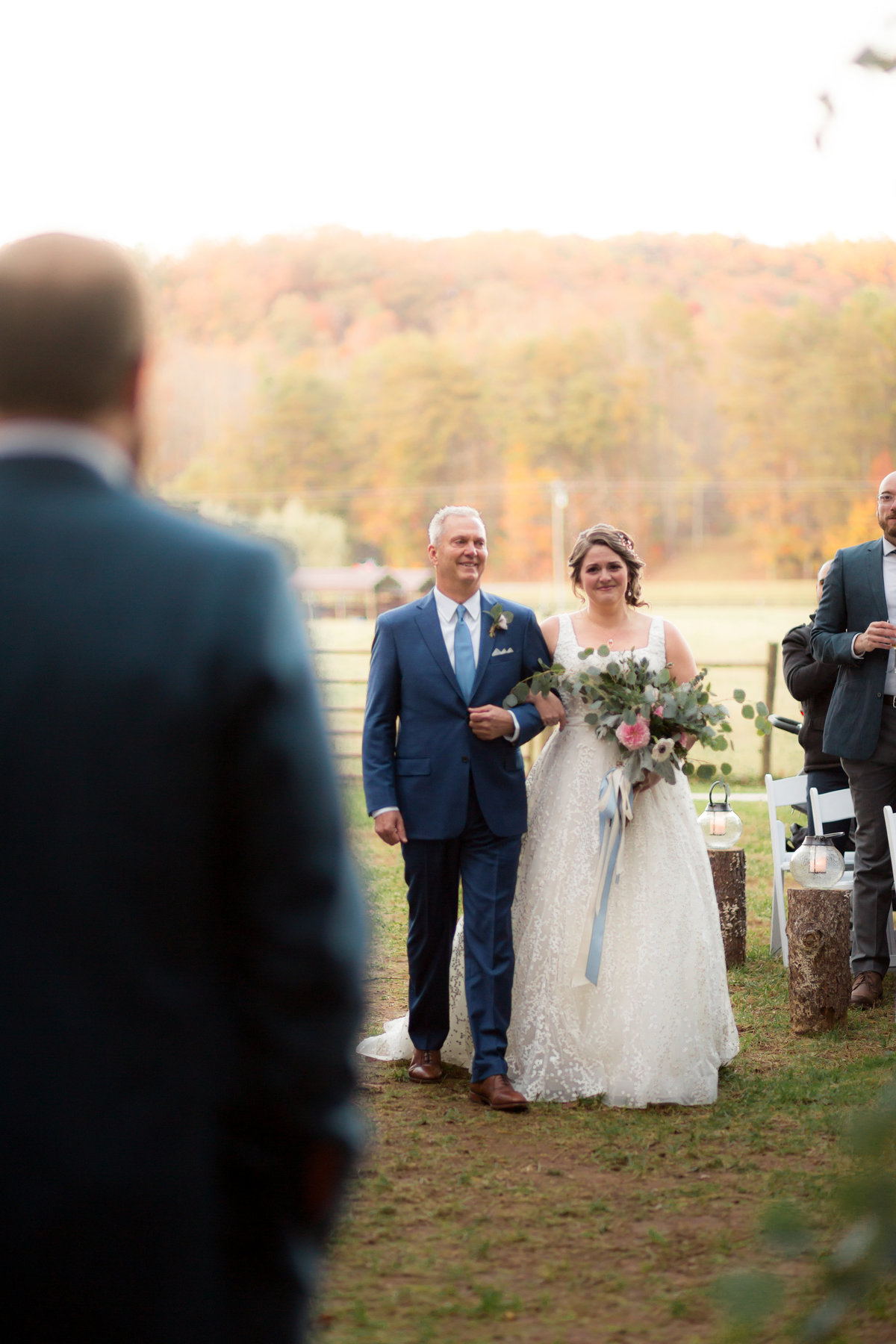 photo of dad walking his bride daughter down the aisle to groom