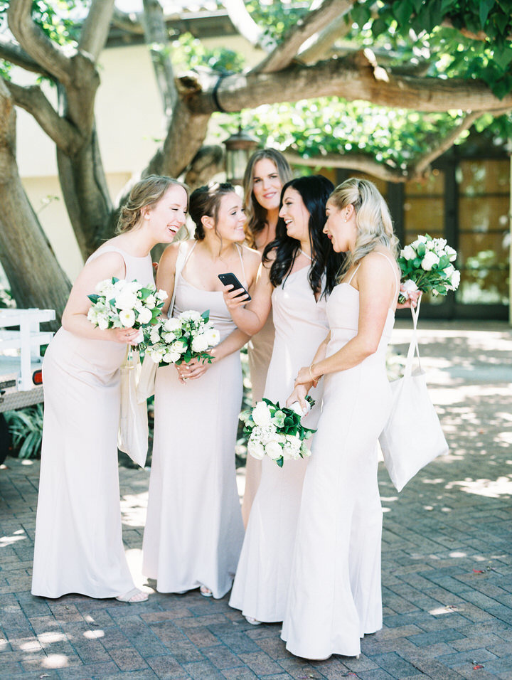 bridesmaids wearing pink gowns