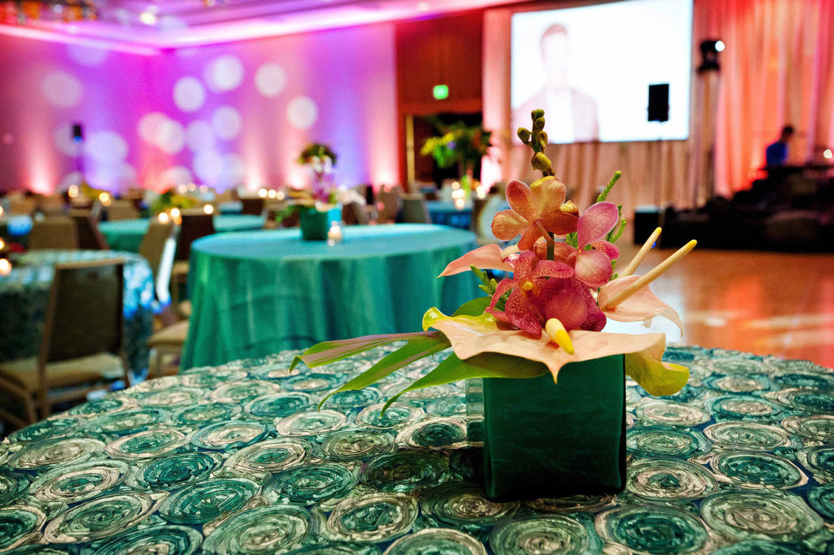 tropical centerpiece on turquoise linen