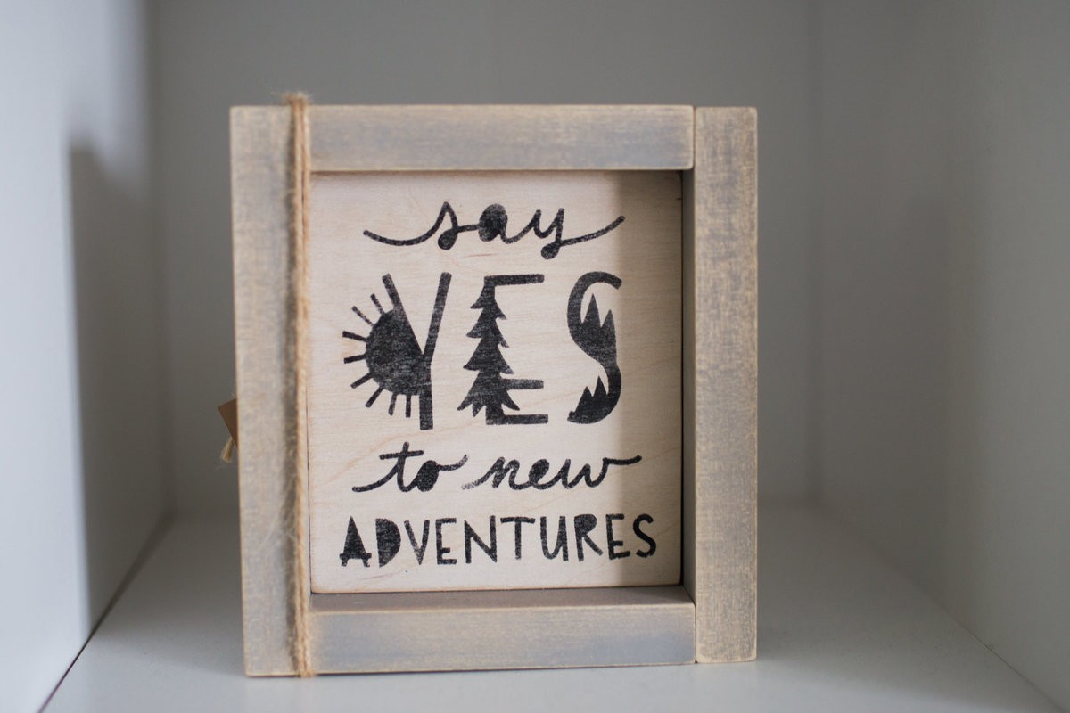 Say yes to adventures artwork in nursery during newborn session with Jennifer BLaak Photography