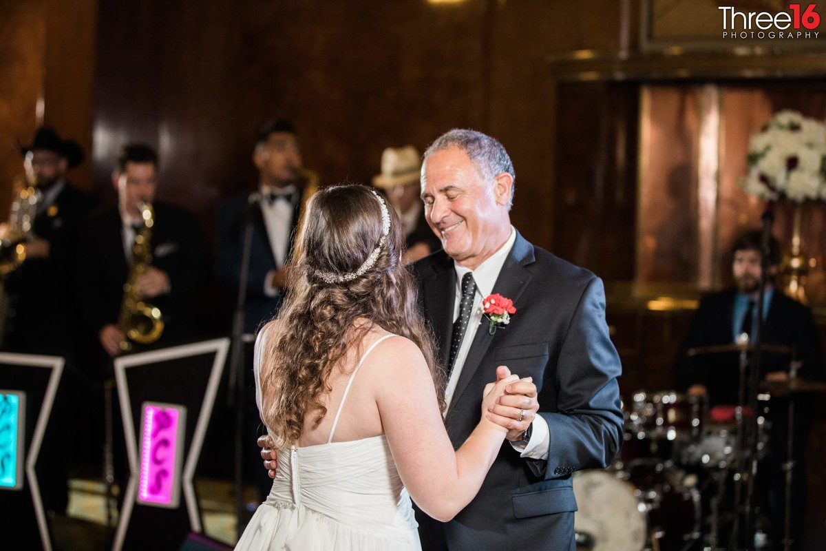 Bride dances with her father at her wedding
