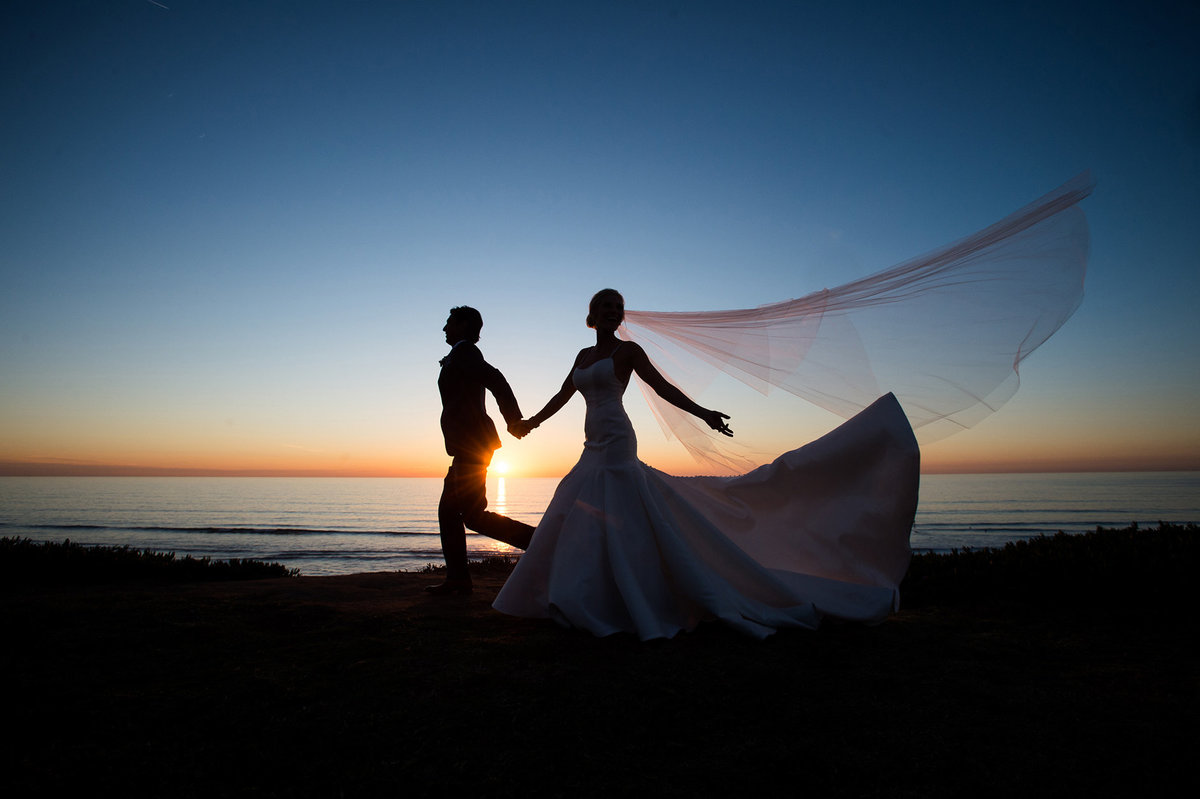 Married couple on beach during sunset