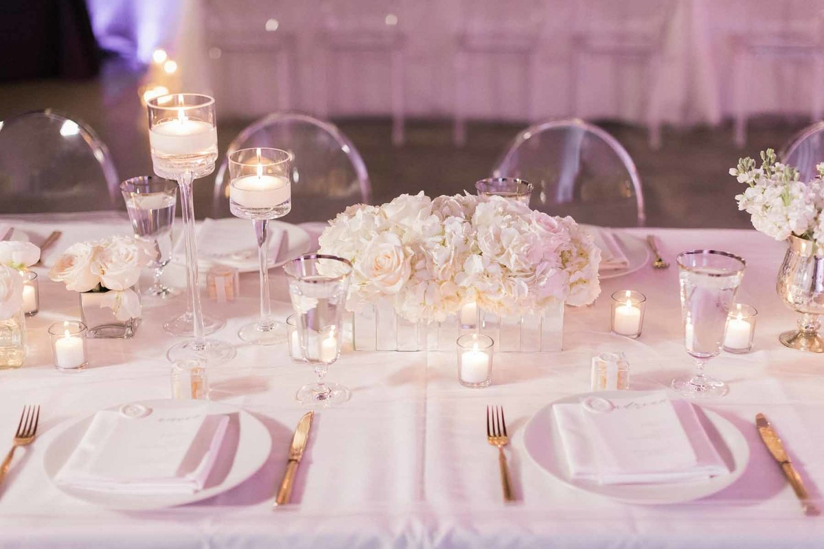This all white table setting  is simple and elegant