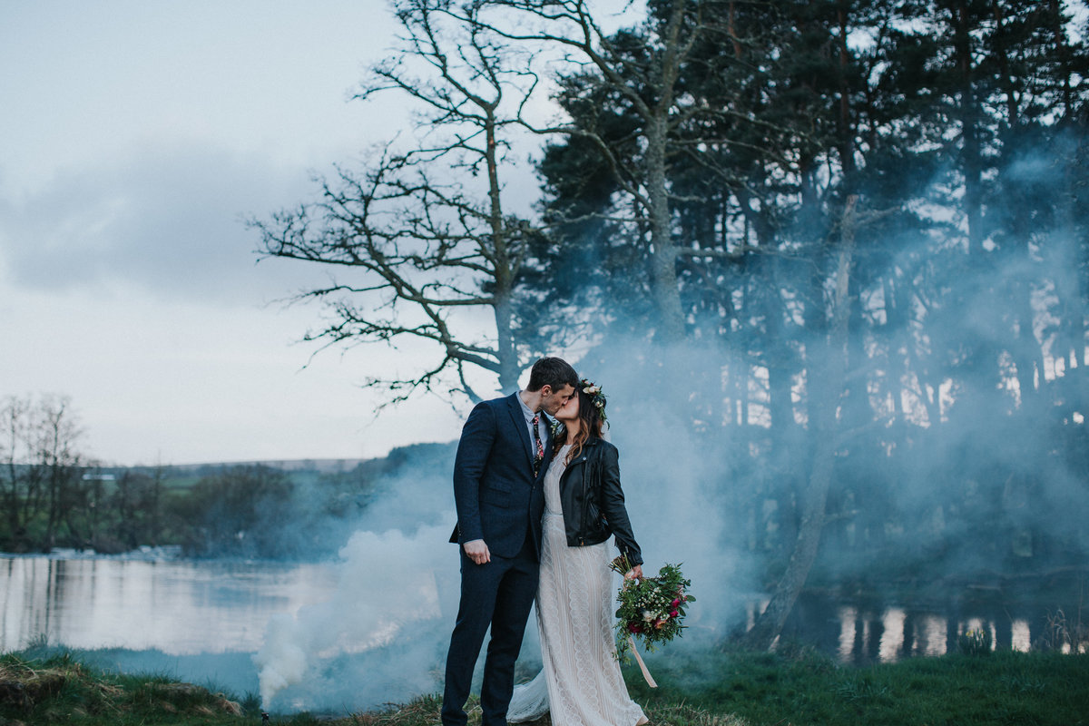 Rock n roll wedding couple with smoke bomb