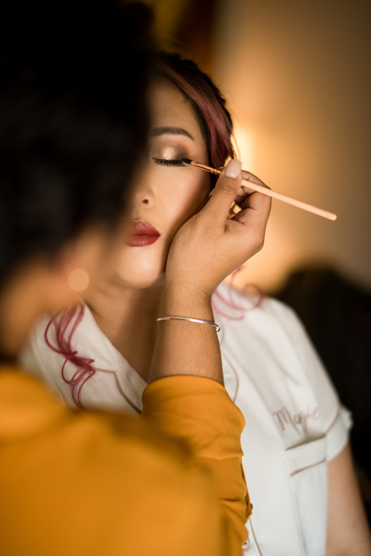 makeup application on a bride during prep