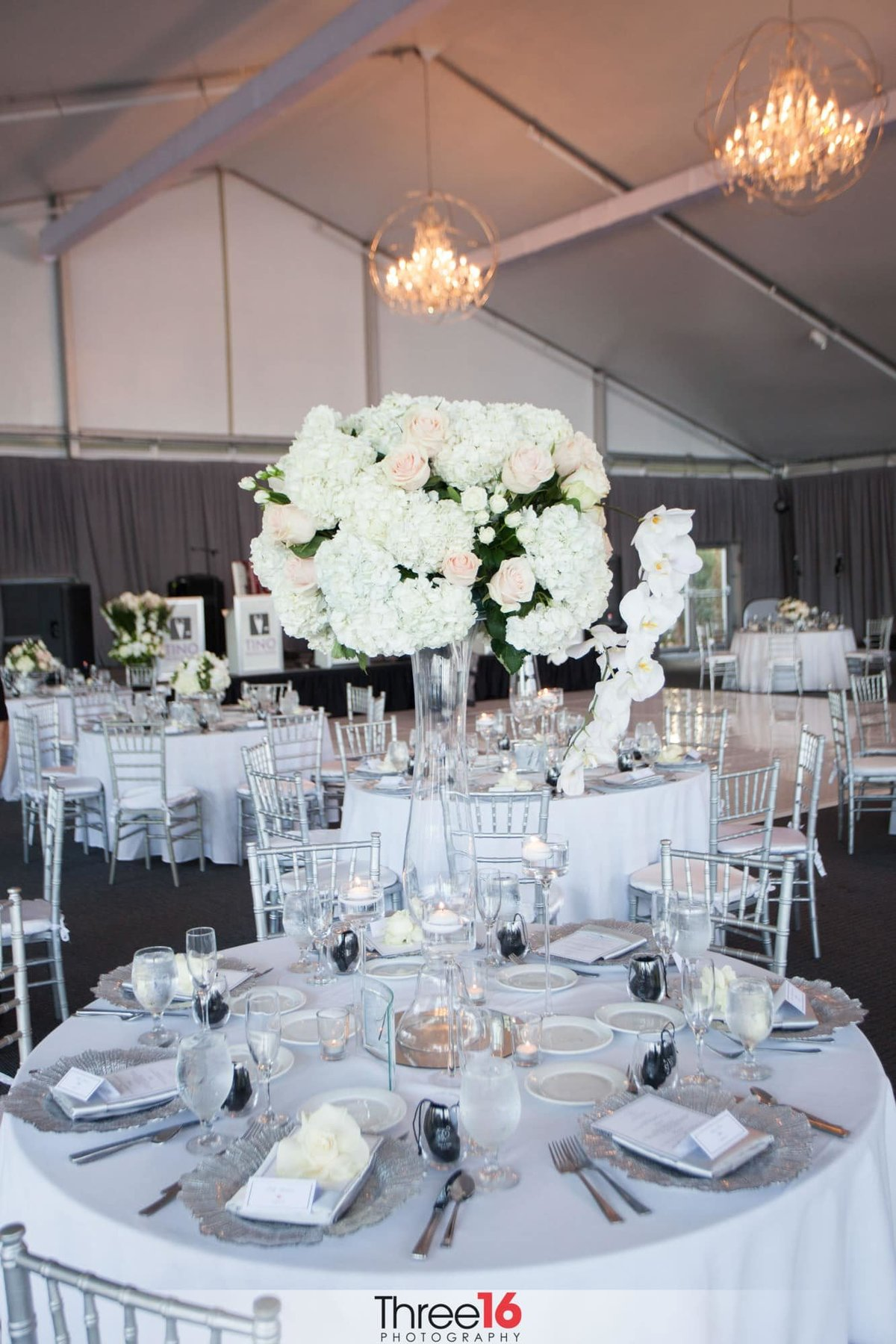 Beautiful wedding reception table setup with large centerpieces