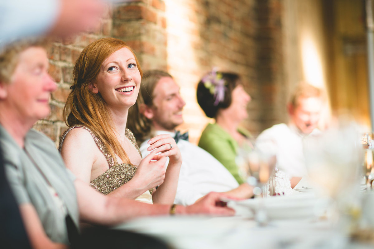 bride laughing in the speeches at a york maze wedding