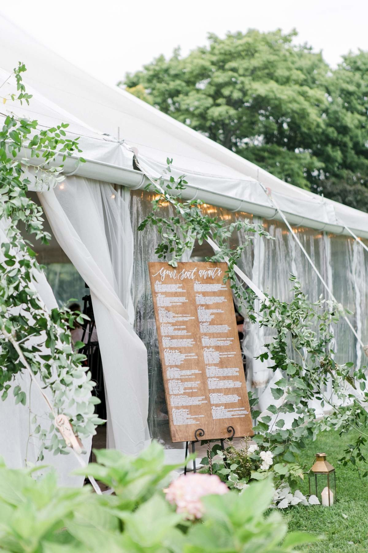 wedding-tent-entrance-with-greenery-welcome-sign
