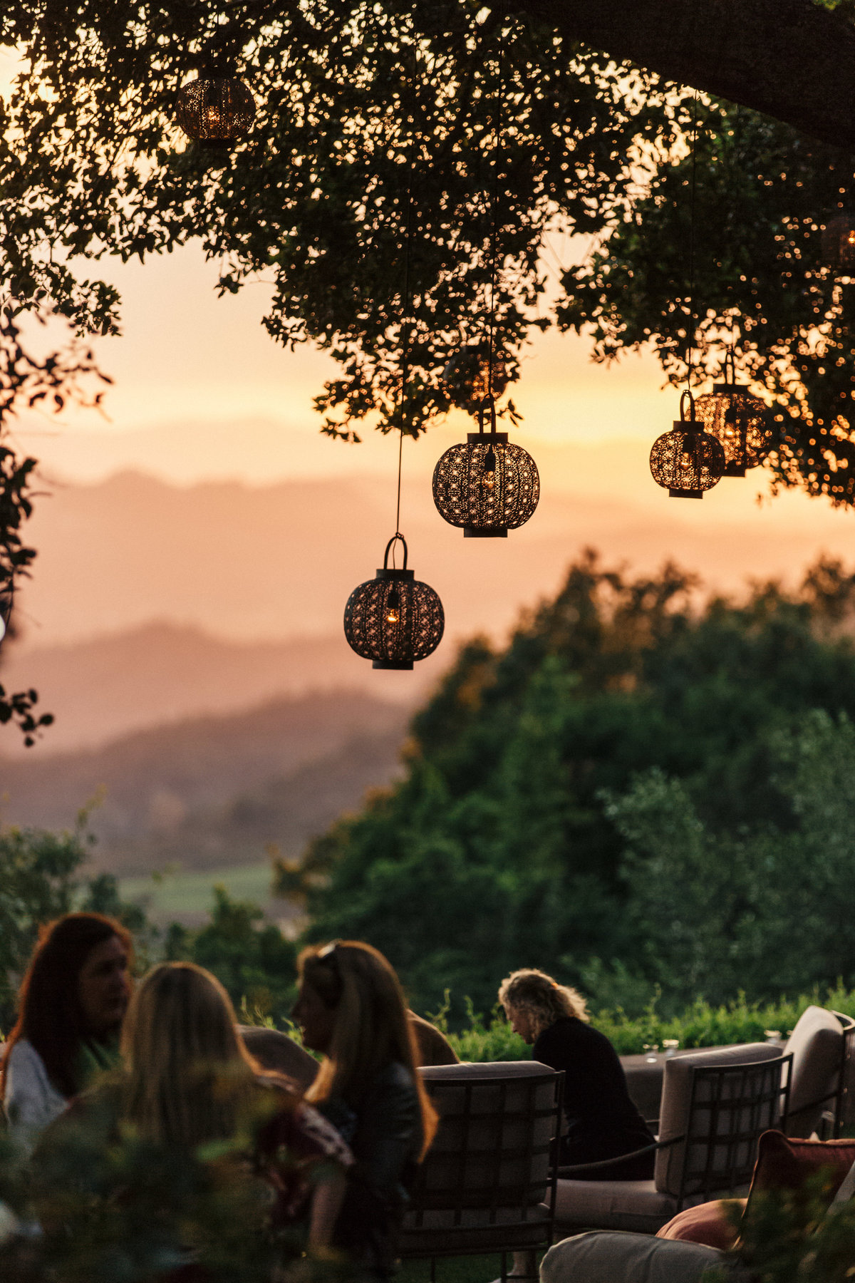 50th birthday scene with lanterns by Jenny Schneider Events at private residence in Napa Valley, California.