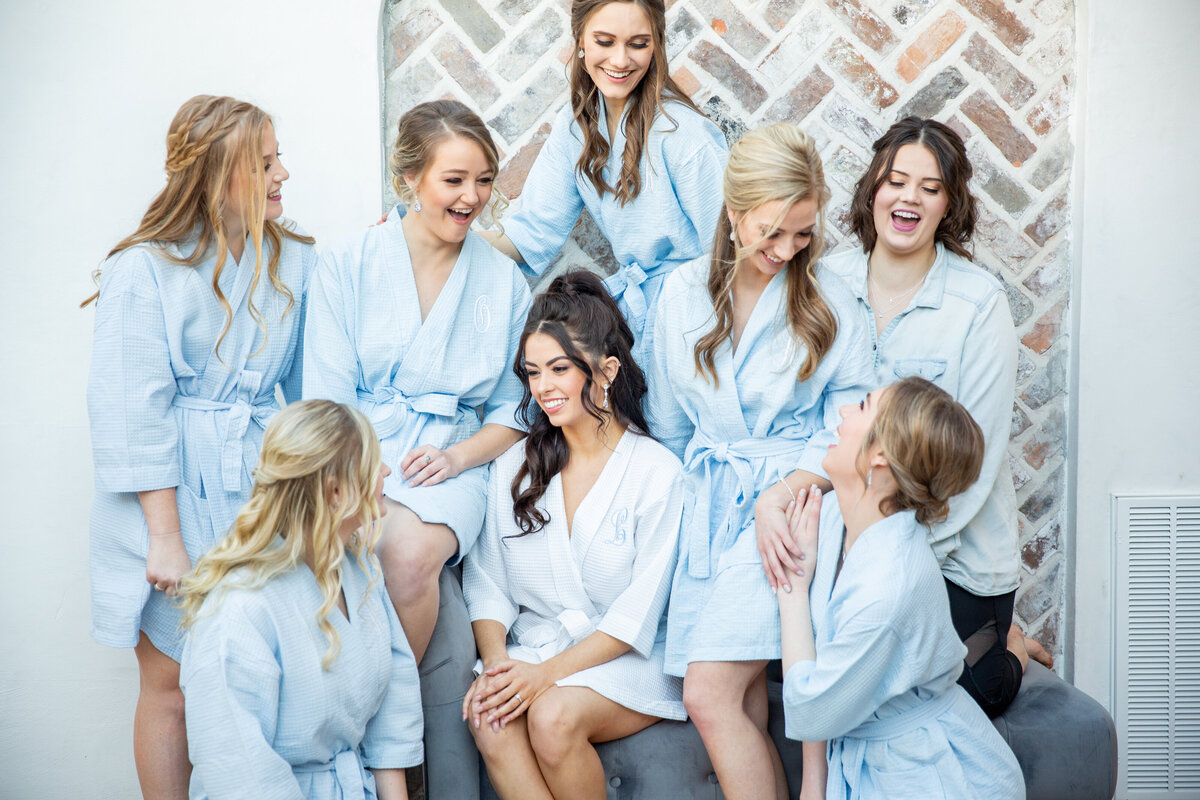 Bridesmaids Laughing Together in Matching Robes at Iron Manor