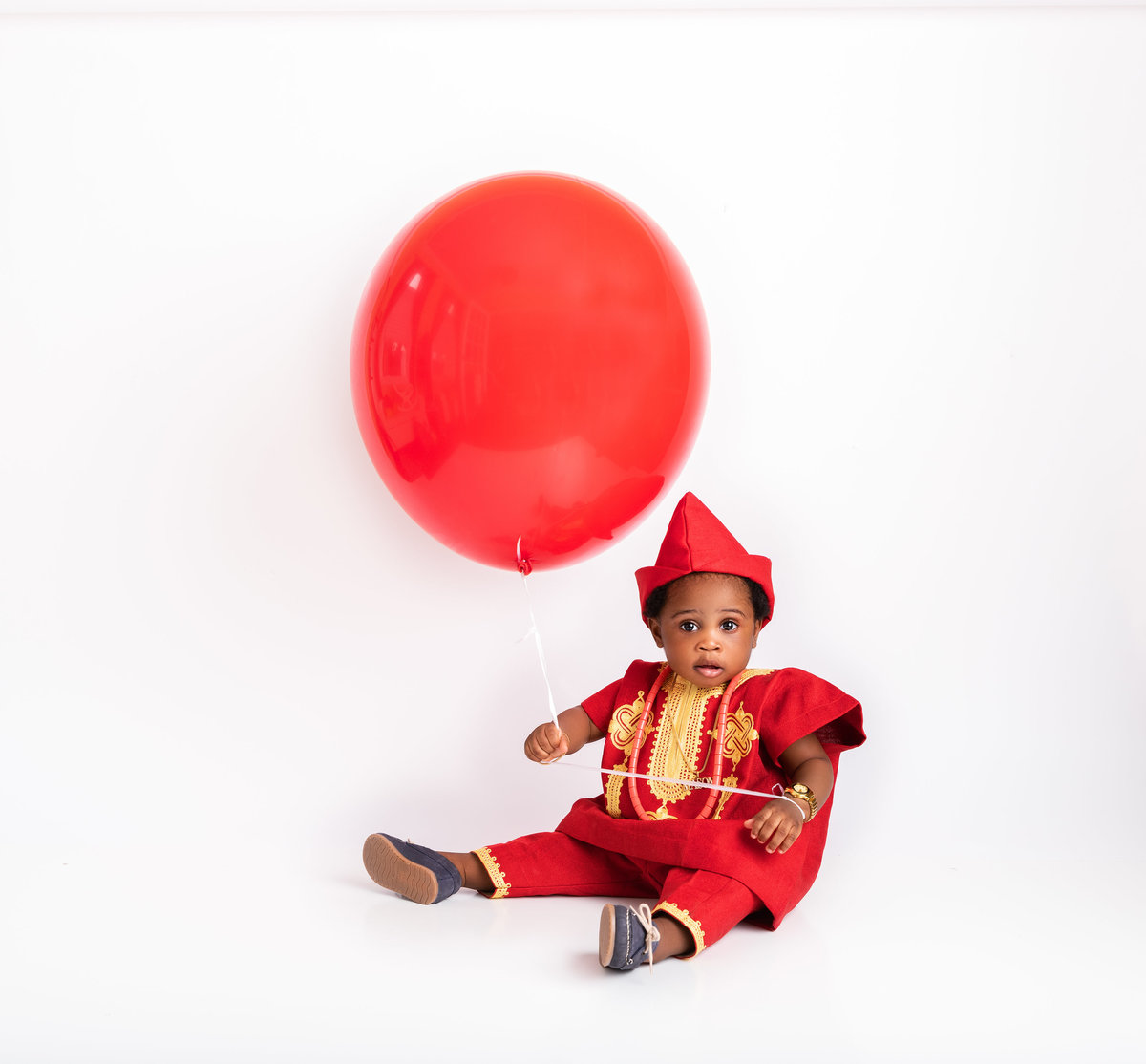 baby boy and big red balloon
