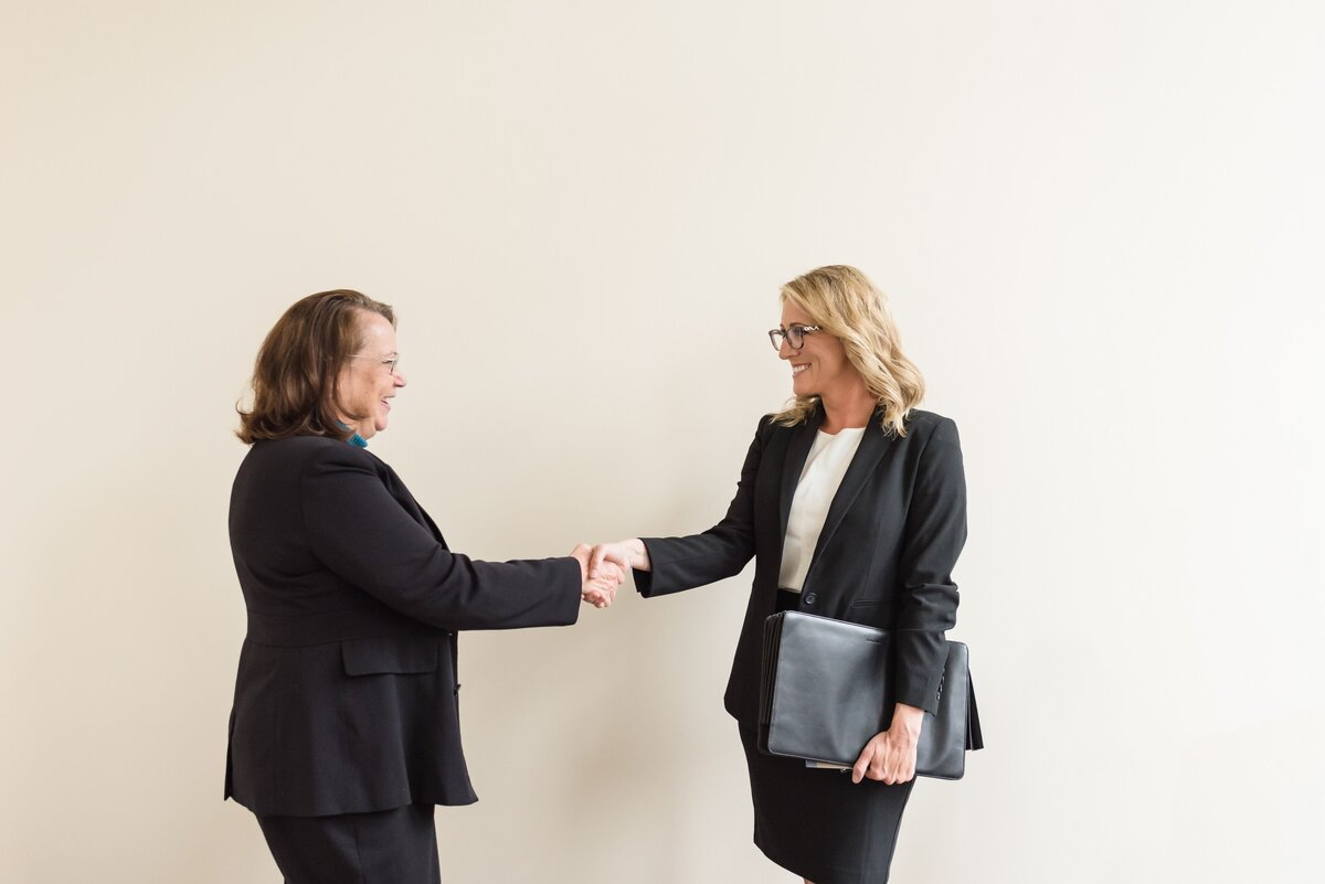 Nashville attorney shaking hands with a client in her law office at The Ralston Firm in Gallatin