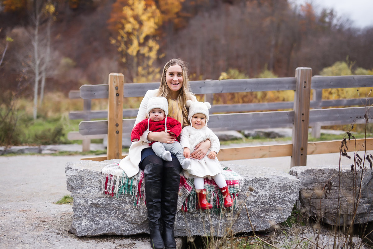 Mother holding her two children by bridge {Burlington Family Photographer}