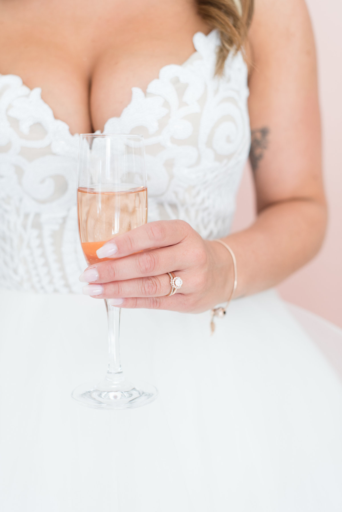 Bride holding champagne glass from Tents & Events in Thunder Bay