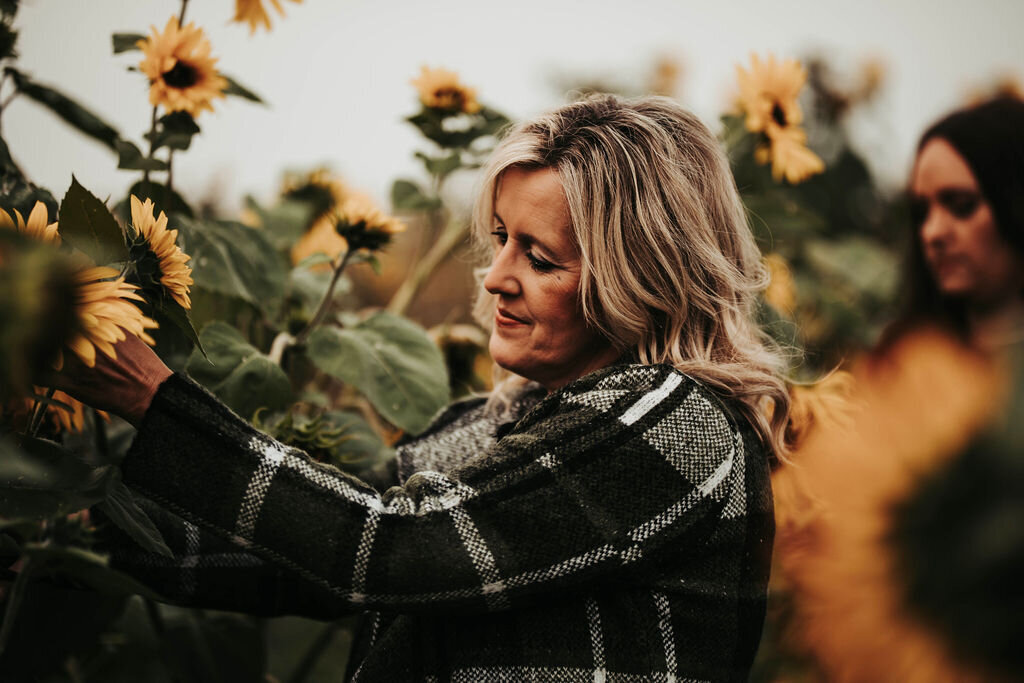 lady by sunflowers