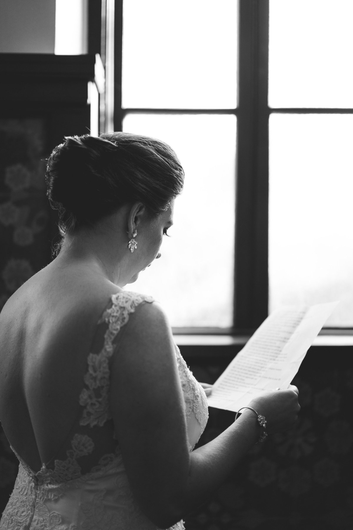 Bride reading over her wedding vows before wedding ceremony at Hotel Emma in downtown San Antonio