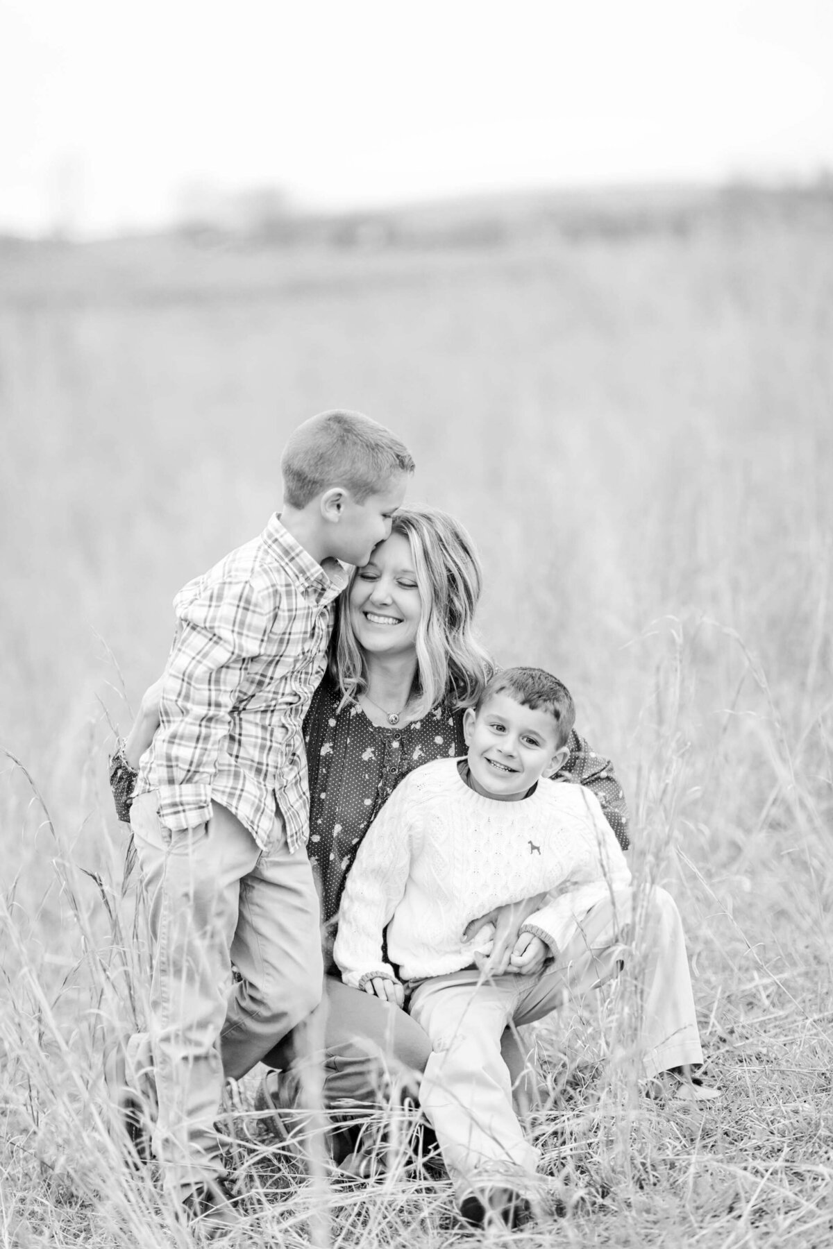 black and white portrait of mom and her two sons
