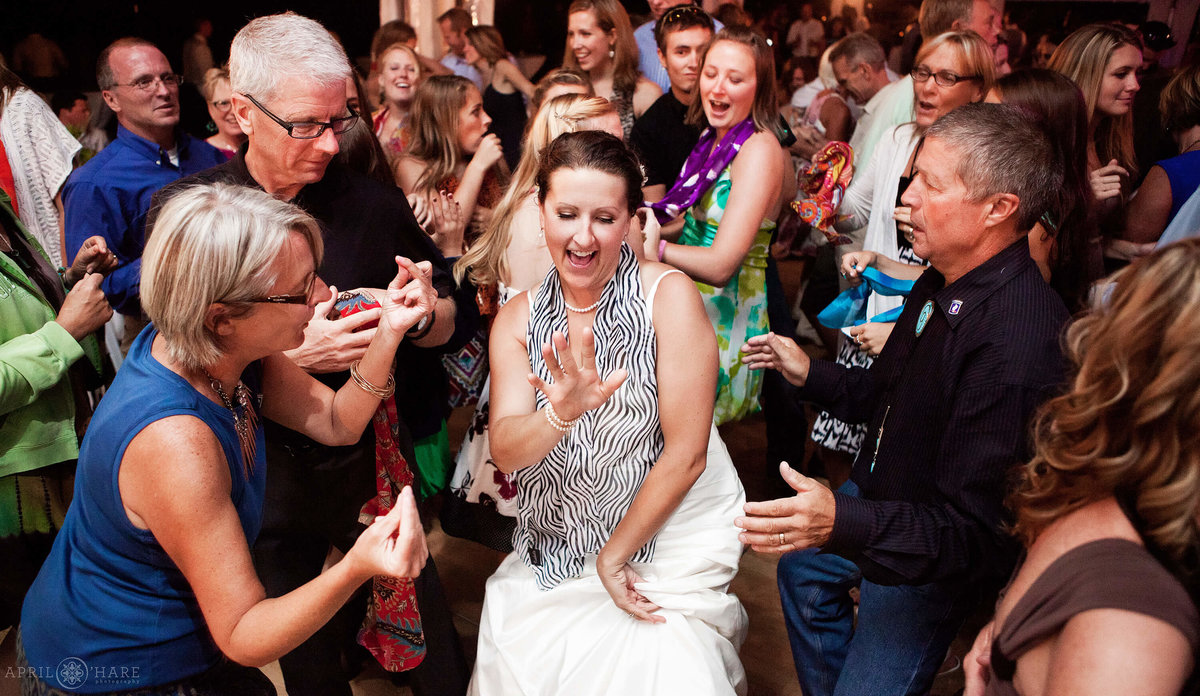 Bride parties on the dance floor surrounded by her guests in Steamboat Springs CO