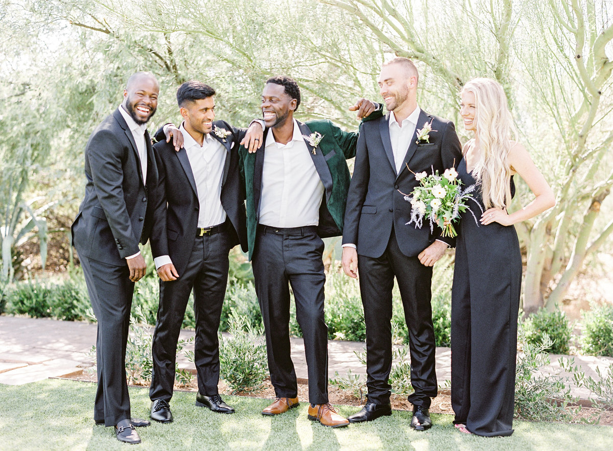 groomsmen - a lady - enjoying their day at El Chorro in Paradise Valley Arizona Photographed by Amy Mulder Photography