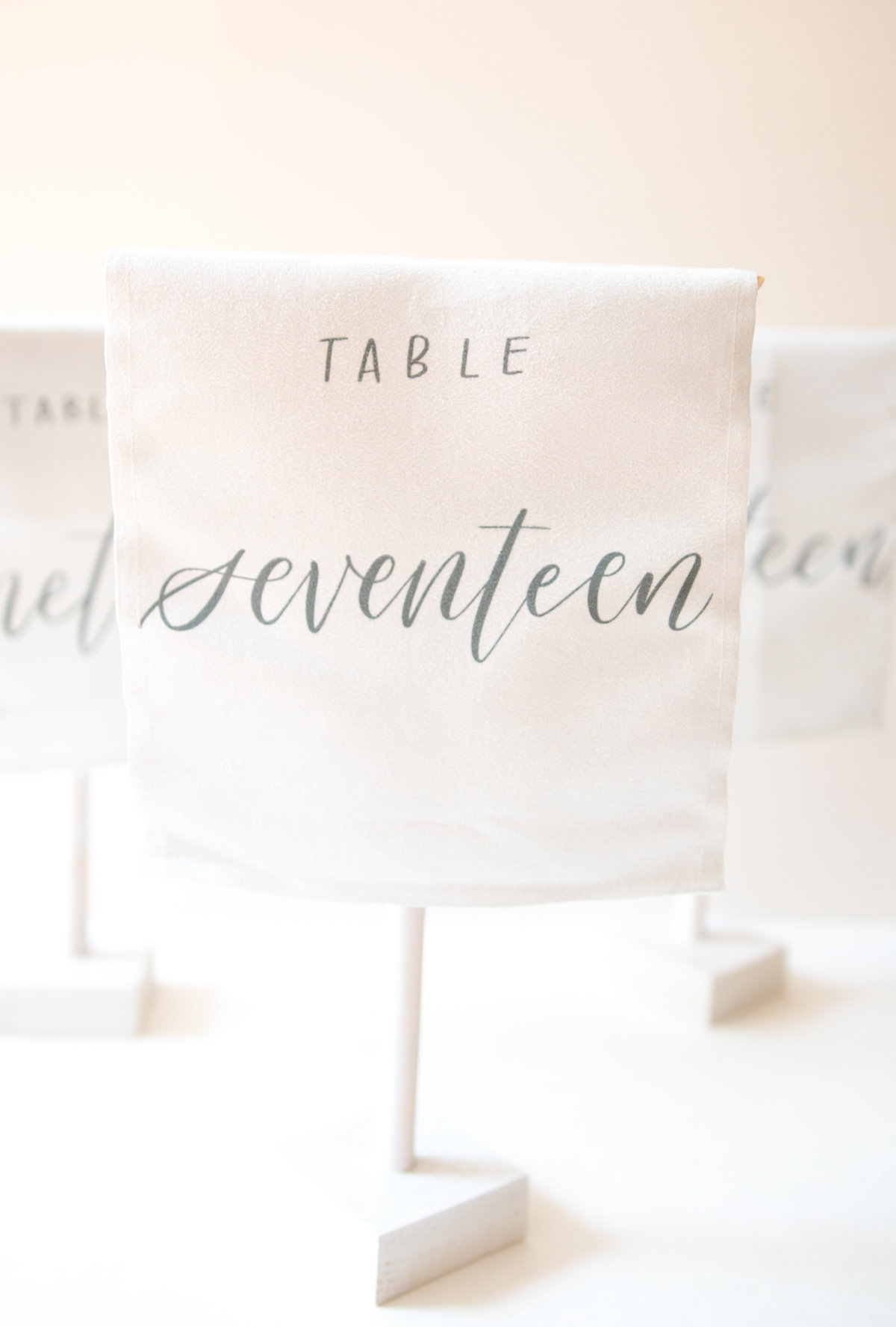 white self standing linen table numbers for weddings or events rental through Hue + FA rentals